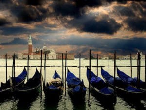 Venice-Shore Excursions: The typical Venetian gondolas in the evening light