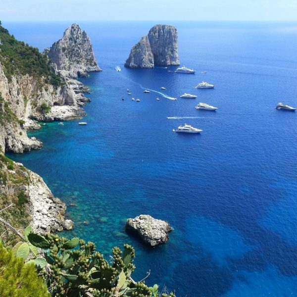 Shore excursion in Naples: Dreamlike azure blue sea in front of the island Capri