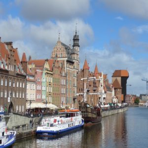 Shore excursion in Gdansk: View from the harbour to the old town of Gdansk