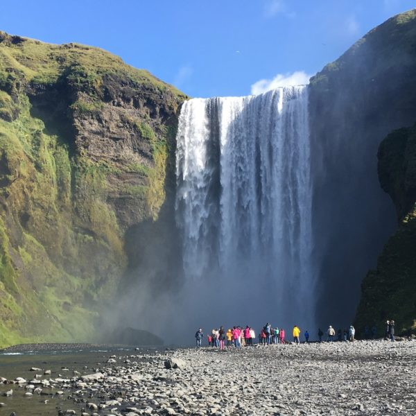 Shore excursion guests in front of Skógafoss waterfall