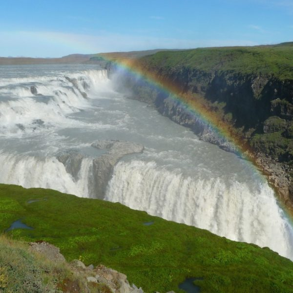 Wonderful rainbow above the waterfall Gullfoss